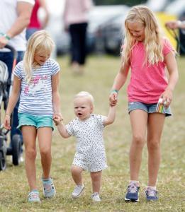 Lena Tindall toddling alongside her big sister Mia, and her royal cousins Isla and Savannah Phillips.